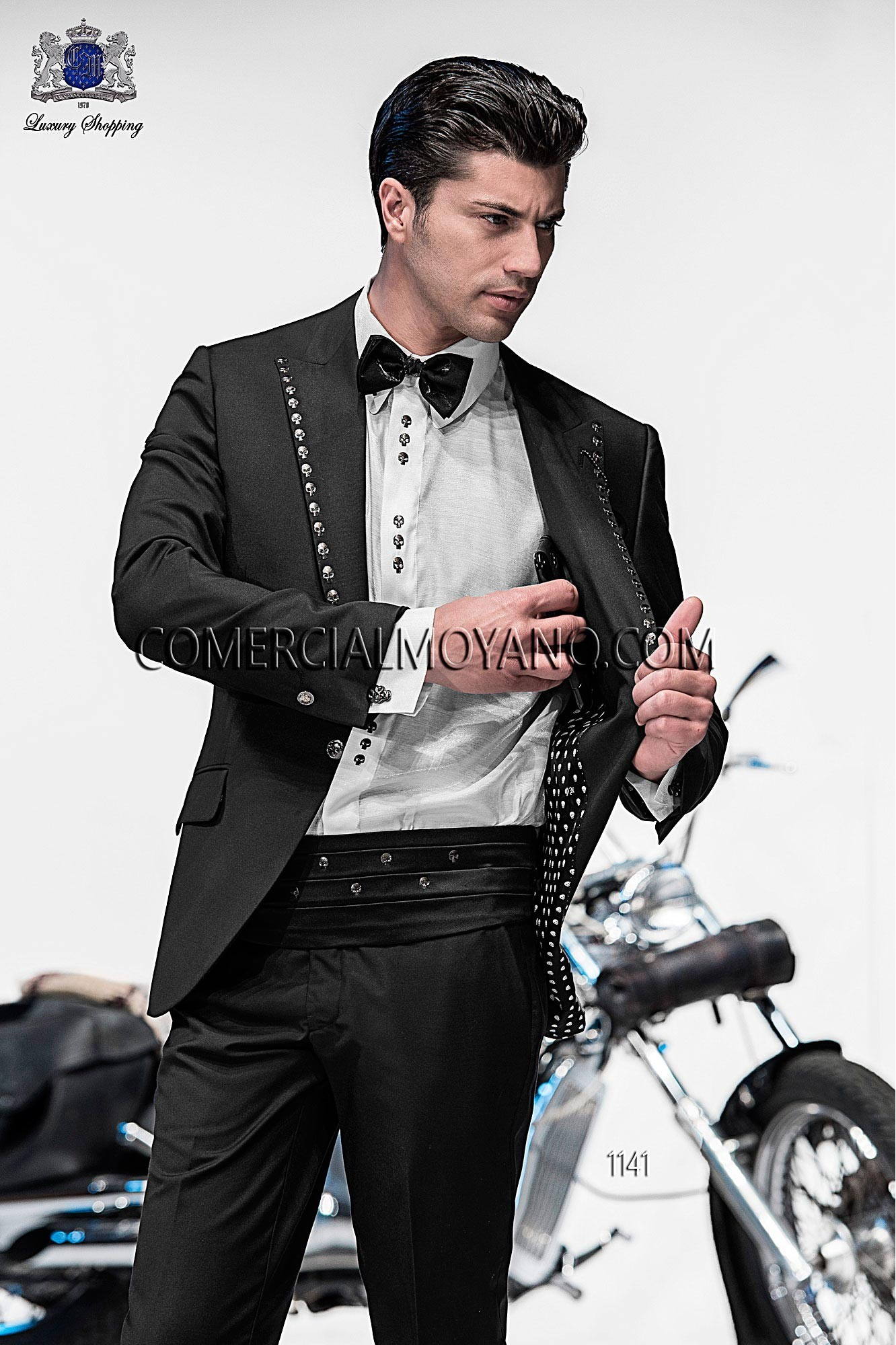 Italian bespoke black fashion suit in New Performance fabric with peak lapel with black crystal applique and single patterned button closure. Flap pockets and angled buttonholes; and single vent at back, style 1141 Ottavio Nuccio Gala, Emotion collection.