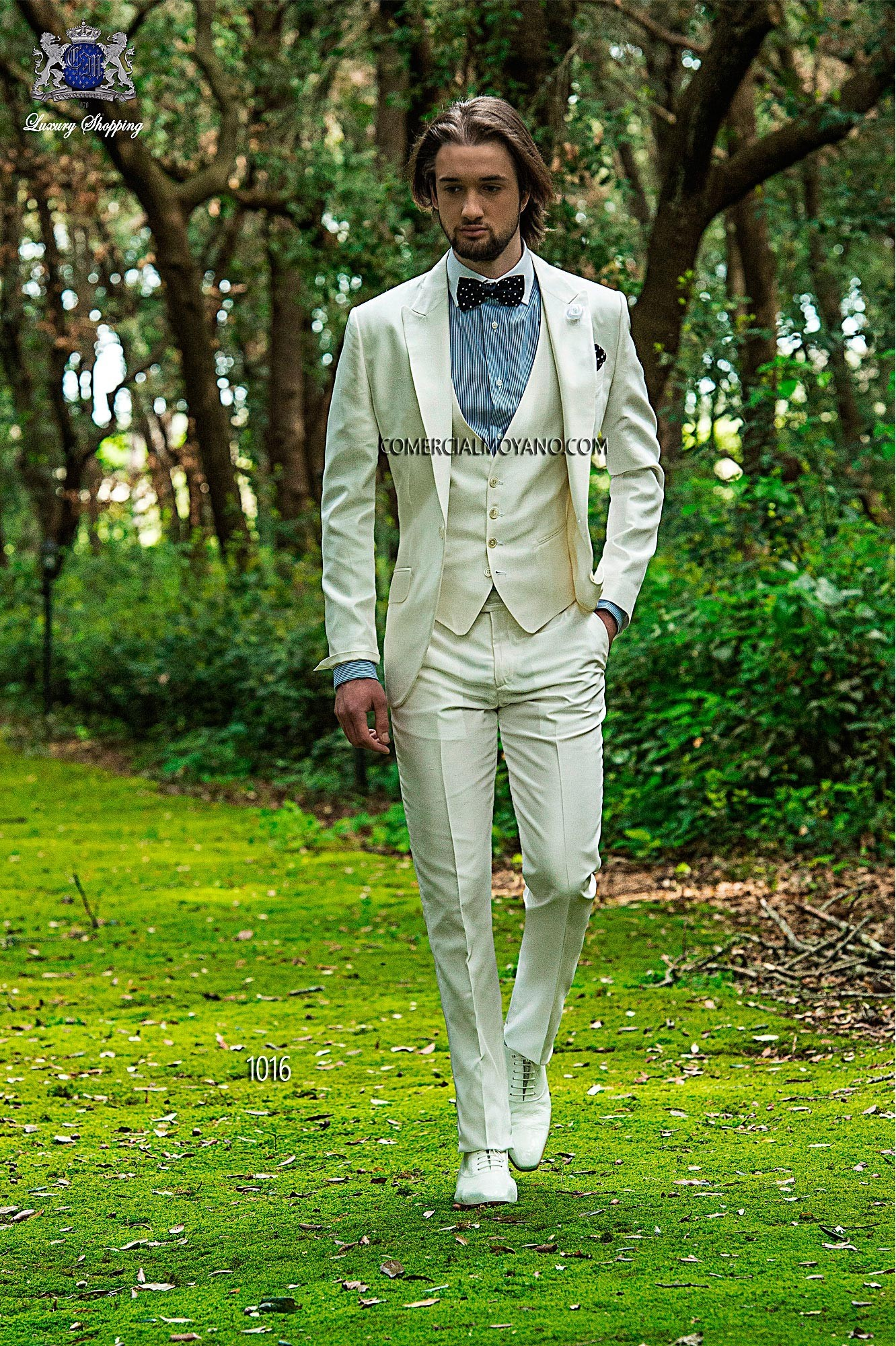 Three piece white silk-acetate shantung suit with peak lapel and single patterned button closure. Flap pockets and angled buttonholes; and single vent at back, style 1016 Ottavio Nuccio Gala, 2015 Fashion Collection.