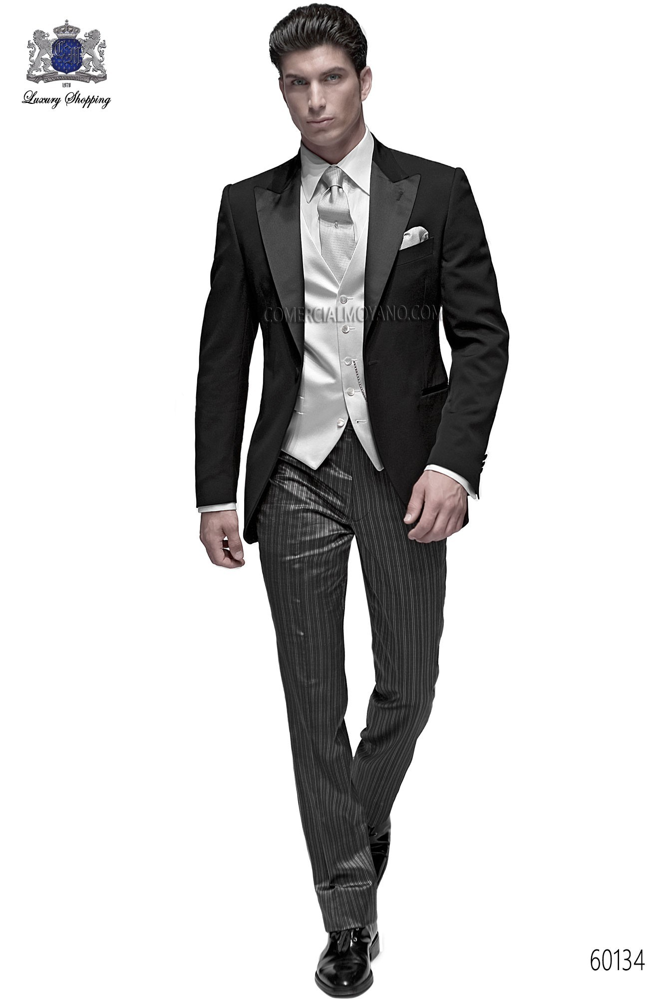 Italian bespoke suit, black jacket in wool-acetate fabric with peak lapel and 1 button closure; with striped trousers, style 60134 Ottavio Nuccio Gala, 2015 Fashion collection.