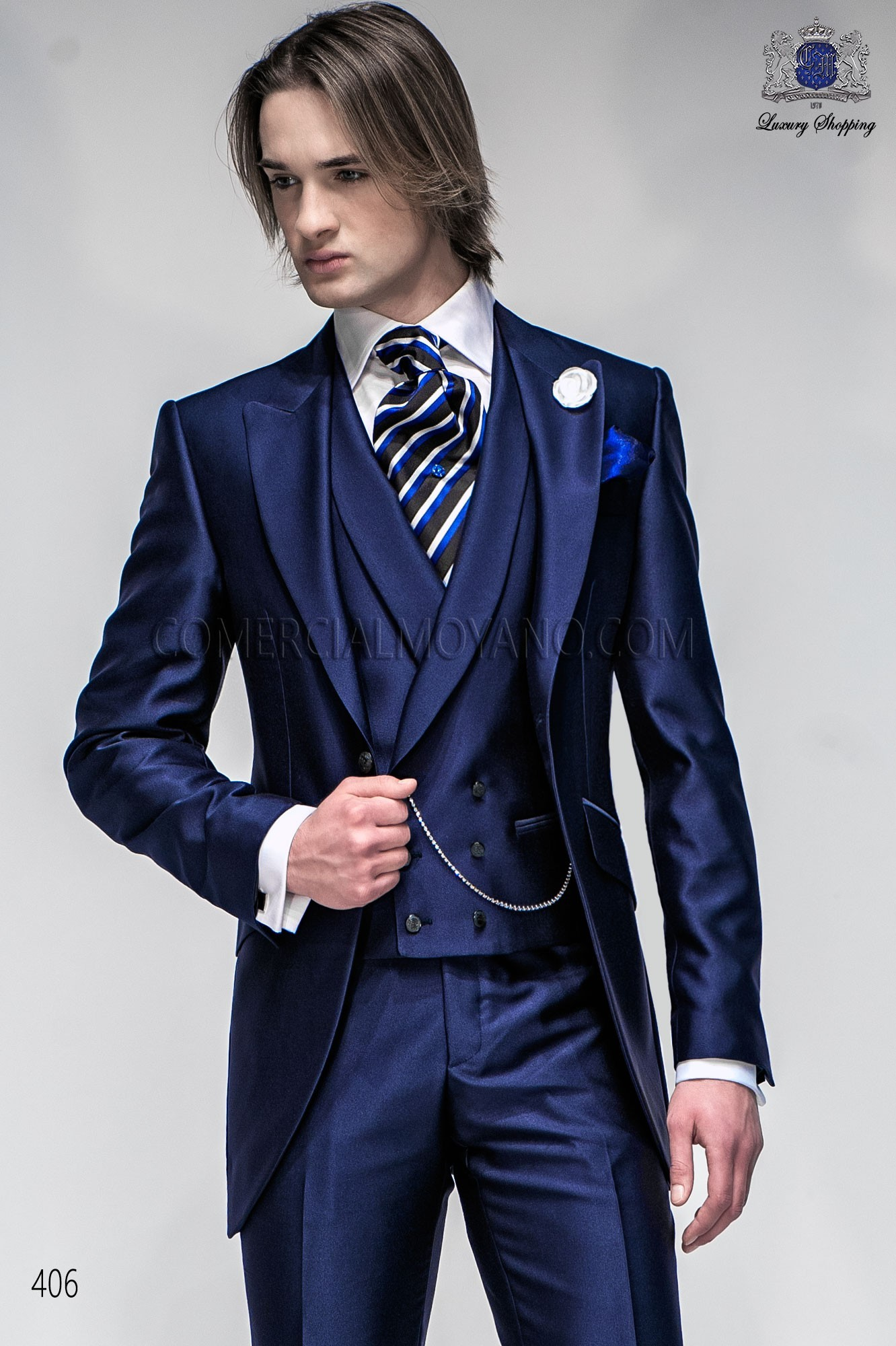 Men wedding suit metallic blue short frock coat in New Performance fabric with peak lapel and one button closure, style 406 Ottavio Nuccio Gala Fashion collection.
