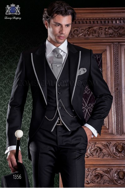 """Chaqué de sastrería italiana de elegante corte """"Slim"""", una apertura. Tejido lana negro con vivos en contraste."""