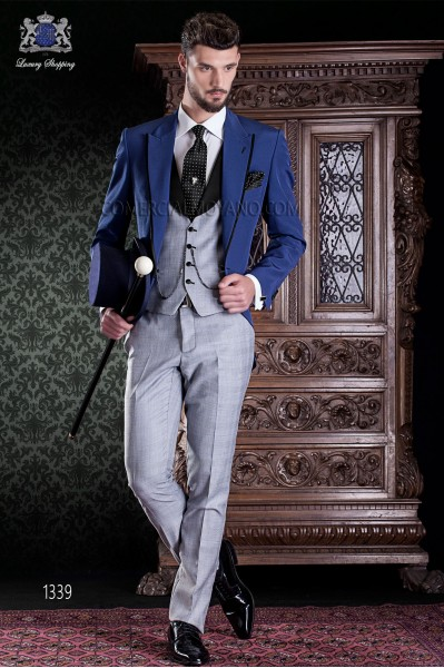 """Chaqué de sastrería italiana 2 piezas, con corte """"Slim"""", una apertura. Tejido de lana azul con Príncipe de Gales."""