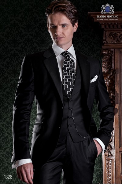 "Italian tailoring suit with elegant cut ""Slim"" and Cerillera pocket. Satin black wool fabric."