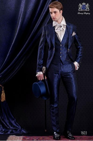 Traje de novio Barroco. Levita de época en tejido brocado azul y negro con broche fantasía.