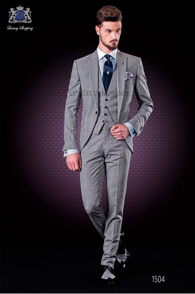 "Italian suit with modern ""Slim"" peak lapels and one button. Fabric Prince of Wales design with thin blue stripe"