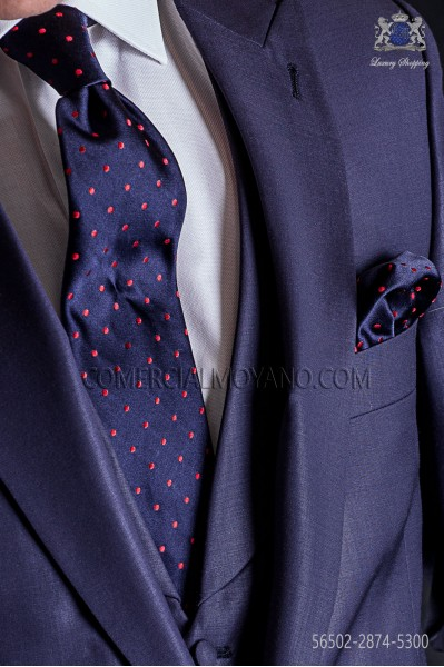 Navy blue tie with red polka dots and matching pocket handkerchief