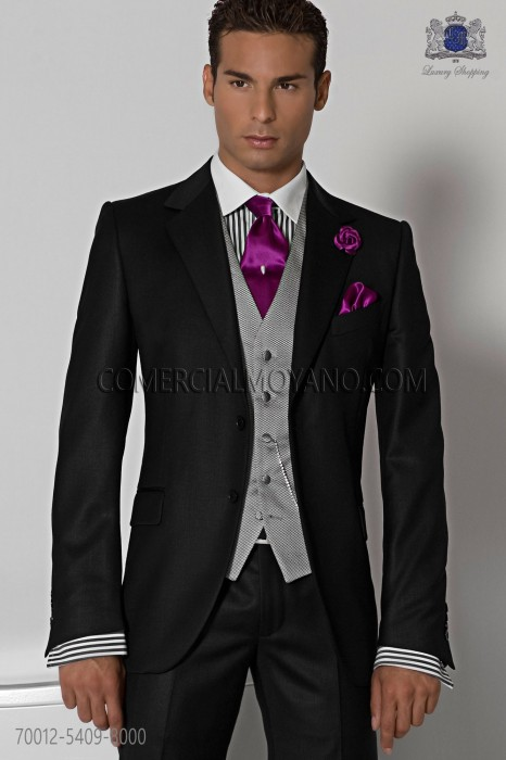 "Italian tailoring suit stylish cut ""Slim"" two buttons. 100% black wool fabric."