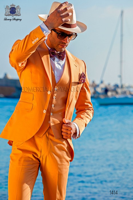 "Italian suit with modern ""Slim"" flap ""V"" and 2 buttons. Orange woven 100% cotton"