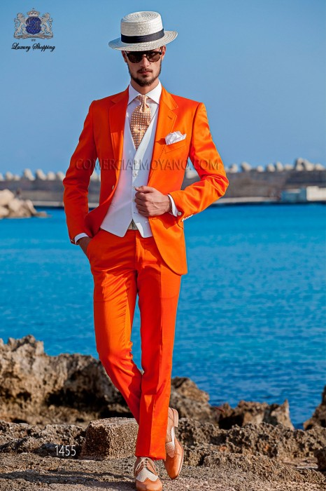 "Modern Italian style costume ""Slim"". Model flaps in ""V"" and 2 buttons. orange 100% cotton."