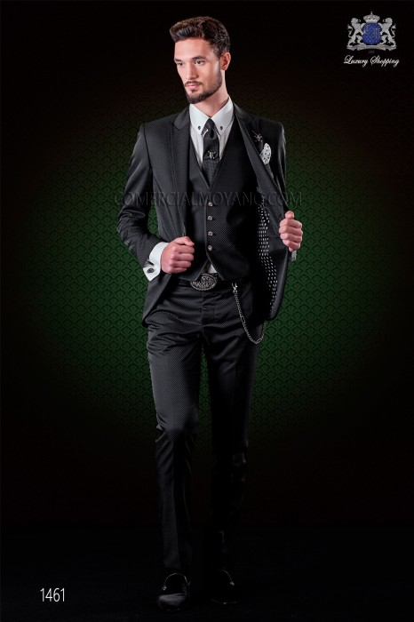 Italian black fashion suit with waistcoat. Peak lapels and 1 button. Wool mix fabric.