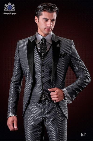 Italian grey monochrome design fashion suit. Satin peak lapels and 1 button. Wool mix fabric.