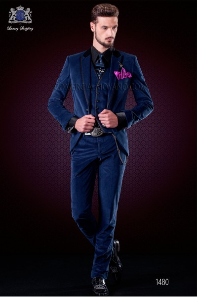 Italian blue velvet fashion suit. Black satin collar, peak lapels with satin trims and 1 button.