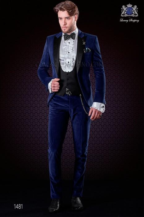 Italian blue velvet fashion suit. Black satin peak lapels and 1 black satin button.