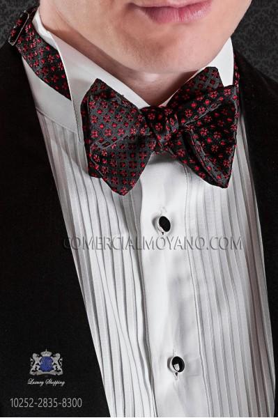 Pajarita de anudar en seda fondo negro diseños rojos