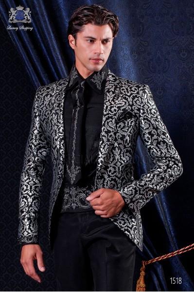 Chaqueta moderna brocada negro y plata. Solapa a punta con 1 botón. Tejido brocado guateado.