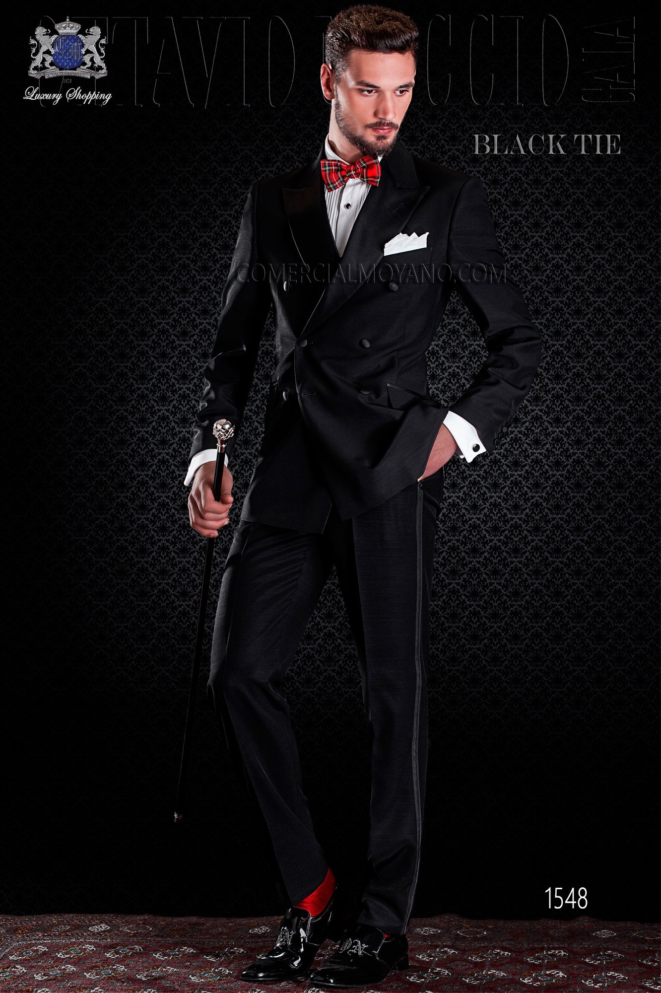 Italian double breasted black tuxedo with satin lapels. Peak lapels and 6 buttons. Wool mix fabric.