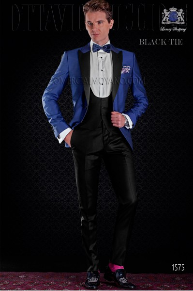 Italian royal blue tuxedo with satin lapels. Peak lapels and 1 button. Wool mix fabric.