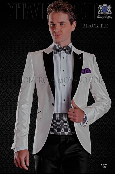 Italian white shantung tuxedo with satin lapels. Peak lapels and 1 button. Shantung silk mix fabric.