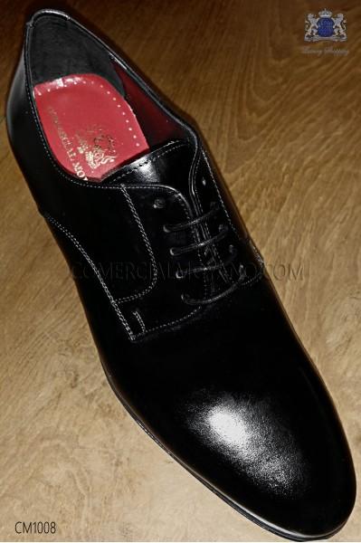 Zapatos negros de cordones en cuero