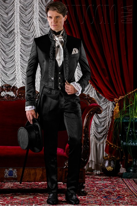 Gothic black satin tail coat with silver embroidery.