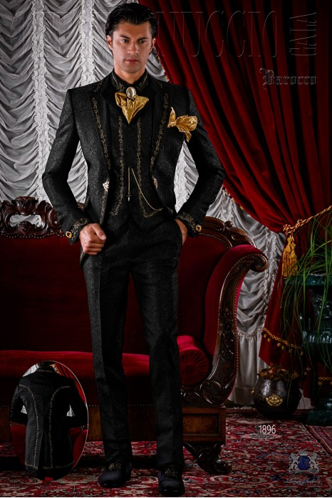 Black brocade baroque frock coat with gold embroidery.