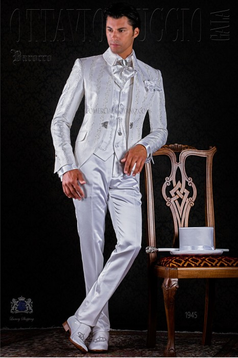 Baroque white brocade frock coat with crystal brooch.