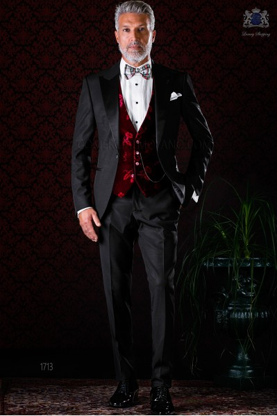 Italian bespoke black tuxedo with peak satin lapels and 1 button. Wool mix fabric.