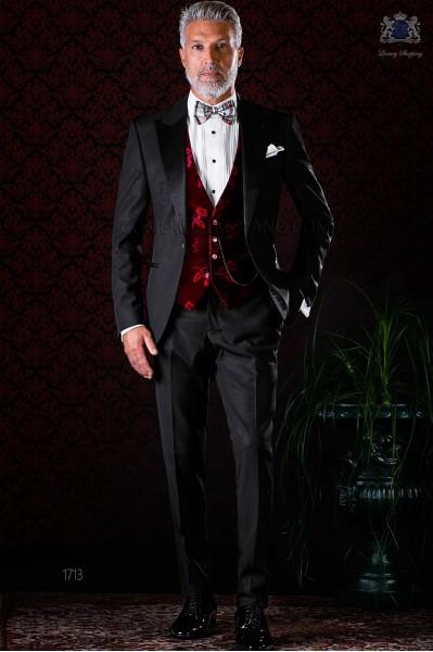 Italian bespoke black tuxedo with peak satin lapels and 1 button. Wool mix fabric.