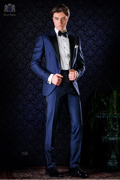 Italian bespoke blue tuxedo with peak satin lapels and 1 button. Wool mix fabric.