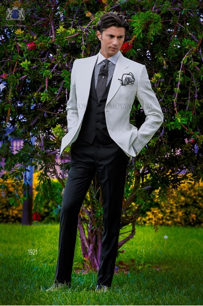Bespoke white linen jacket combined with a black trousers