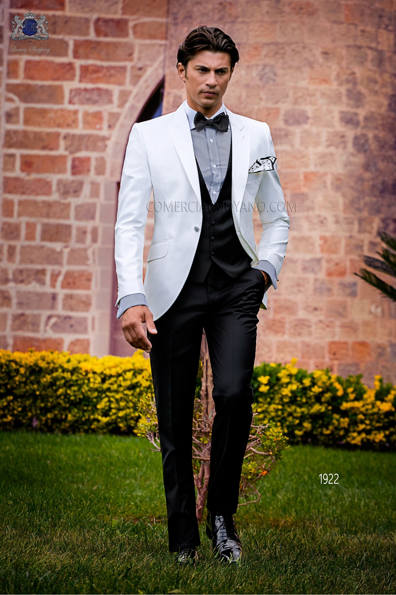 Bespoke white shantung dinner jacket combined with a black trousers
