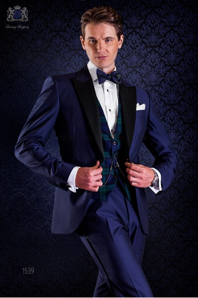 bespoke blue tuxedo with peak satin lapels and 1 button. Wool mix fabric.