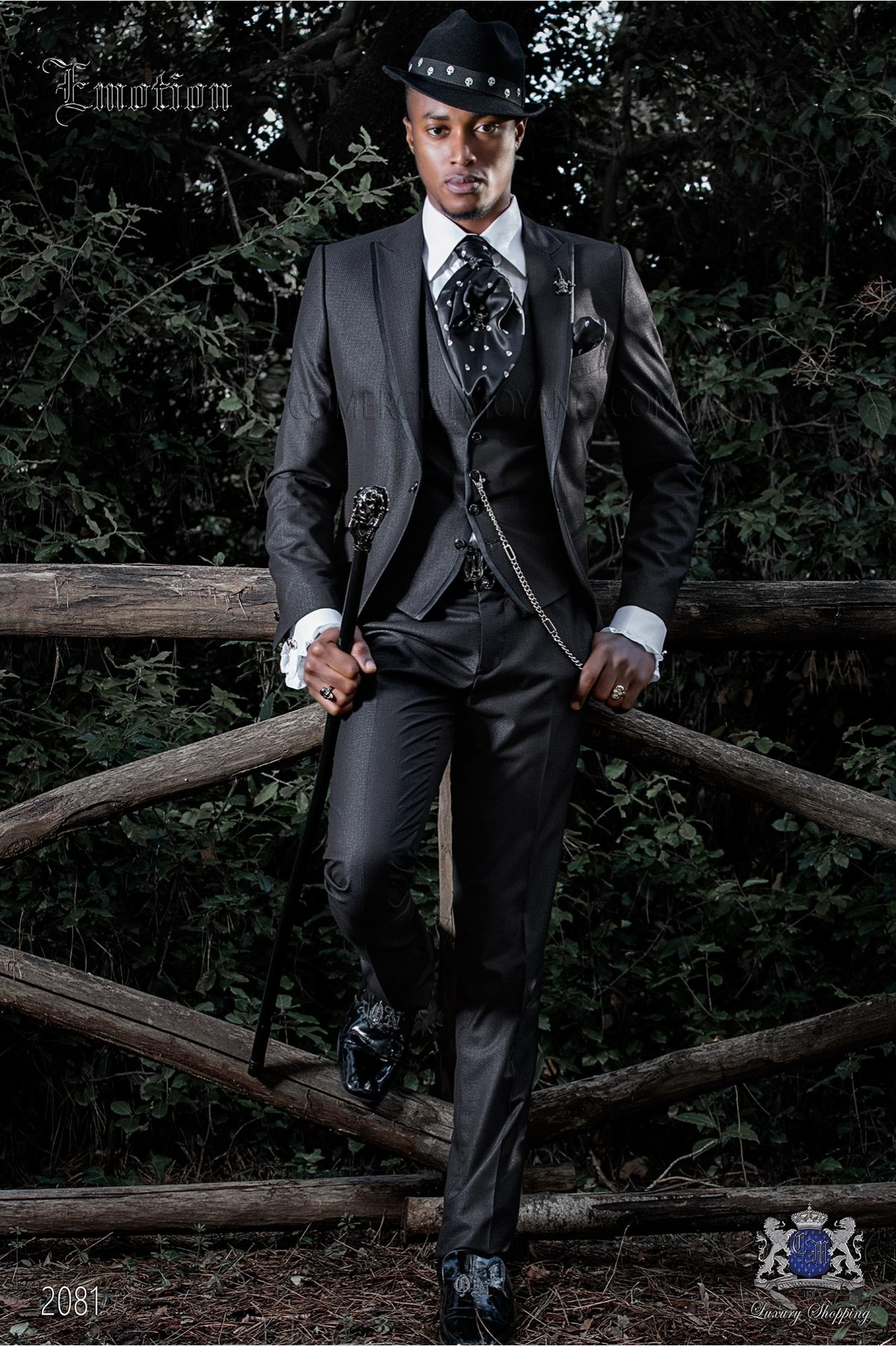 Italian black shiny fashion suit. Peak lapels with satin trims and 1 button