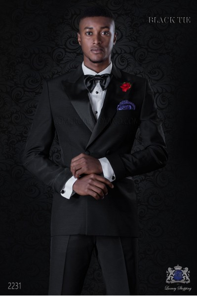 Italian double breasted black tuxedo with peak satin lapels. Peak lapels and 4 buttons. Wool mix fabric.