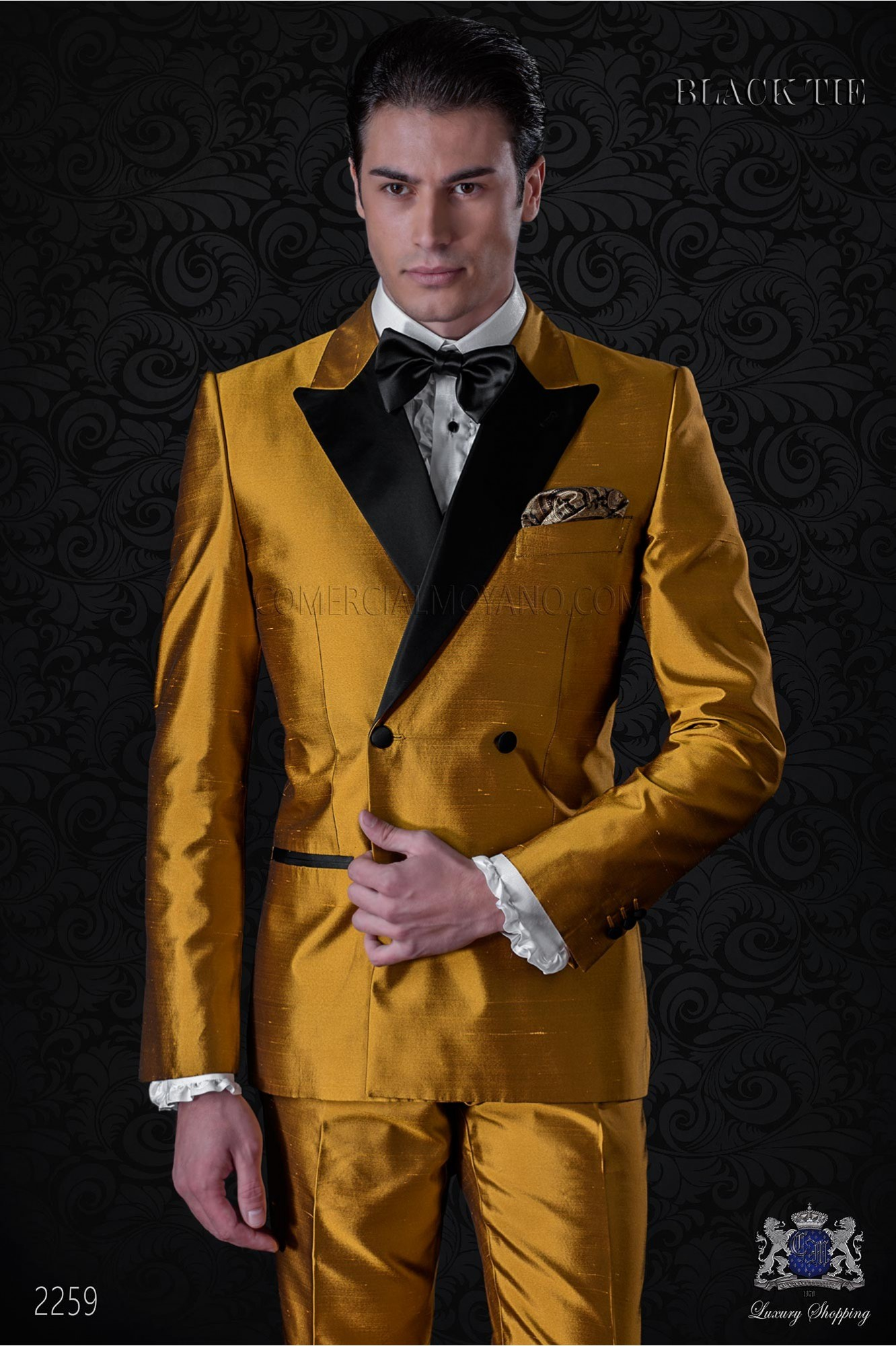 Tuxedo double breasted golden shantung with satin lapels. Peak lapels and 4 buttons. Shantung silk mix fabric