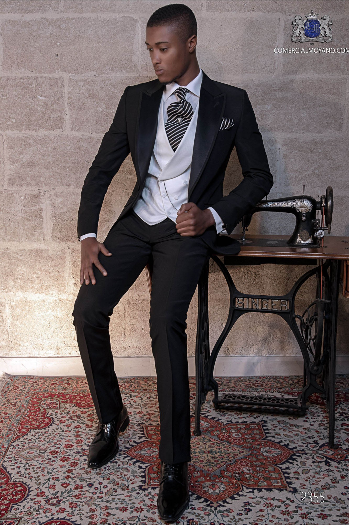Italian wedding suit Slim stylish cut. Peak lapel with contrast fabric piping. Made from wool and acetate fabric in black.