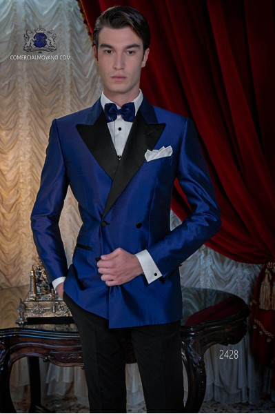 Tuxedo double breasted royal blue shantung with satin lapels. Peak lapels and 4 buttons. Shantung silk mix fabric.