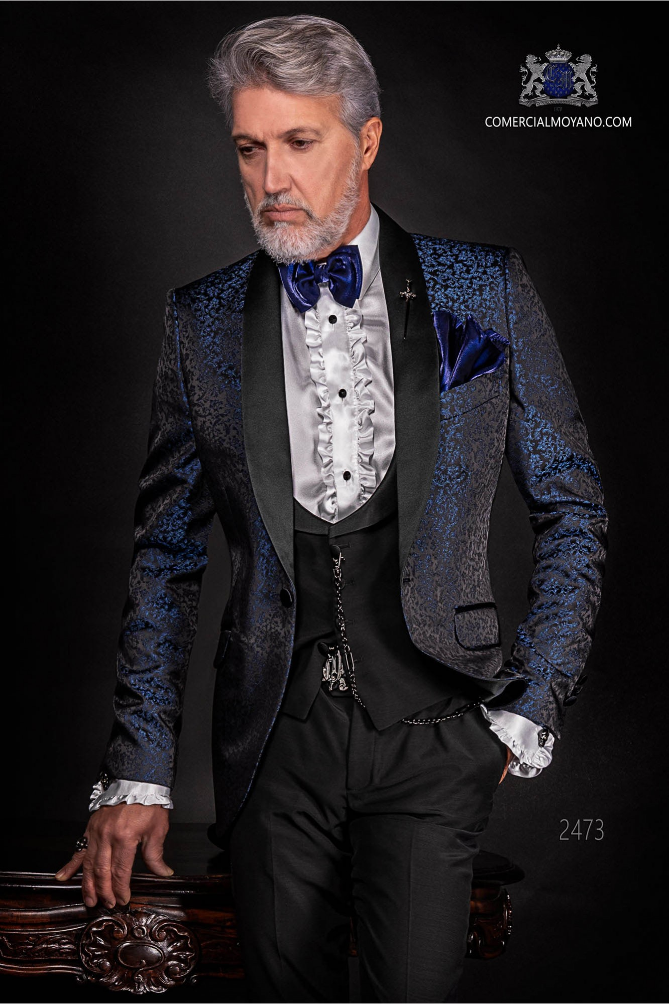 Bespoke black and blue silk dinner jacket combined with a black trousers